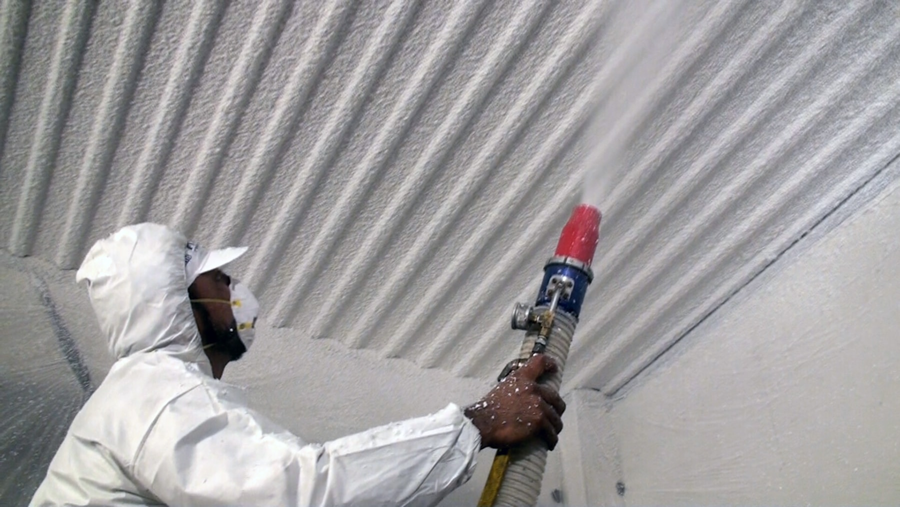 spraying k-13 insulation on ceiling